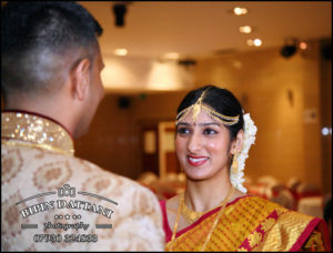 natural candid wedding photography of bride looking at groom