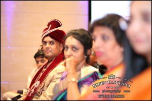 tamil wedding photohraphy focusing on groom waiting to be called in mandap