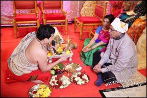 priest with groom parent pre tamil hindu wedding begining