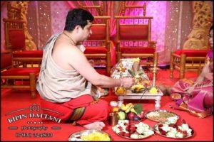 South Indian tamil wedding priest preparing for the hindu wedding ceremomy