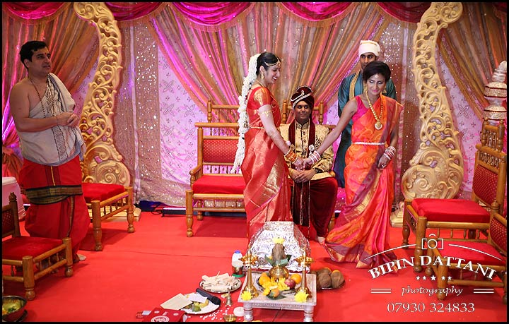 Tamil wedding photographer capturing unusual hindu bridal entrance