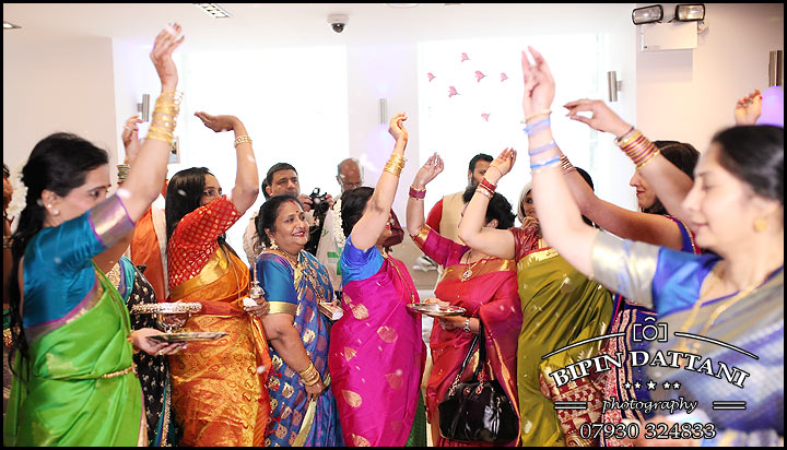 tamil wedding photoshoot of women throwing flowers for good luck