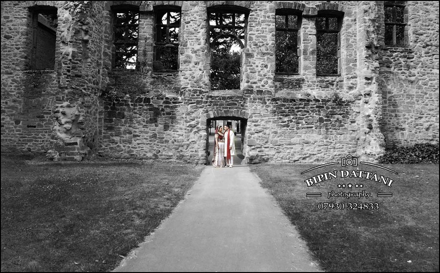 best indian wedding photographer UK using Abbey Park ruins for top couple portrait