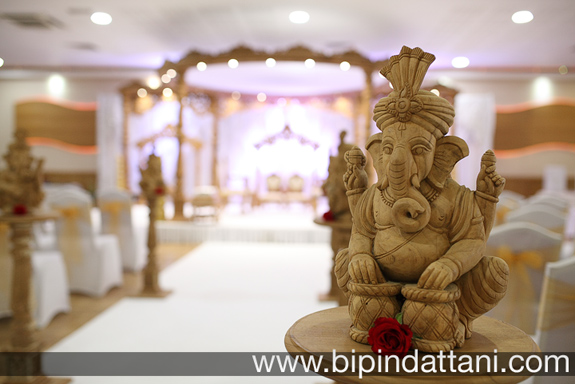 latest wedding stage decor photos of Ganesh for Indian wedding decoration photography at begining