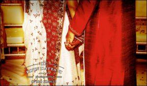 asian wedding photography at Hilton milton keynes holding hands