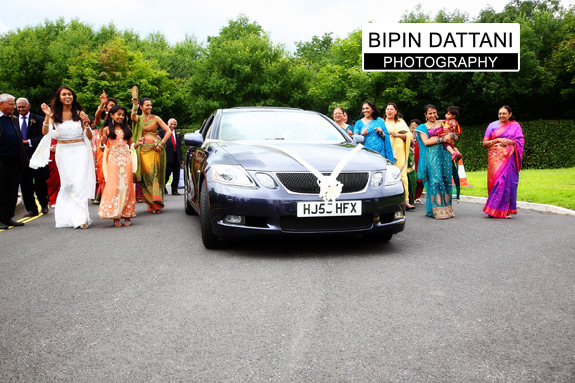 Indian groom arrival in wedding car at oshwal centre wedding