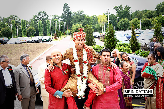oshwal centre wedding with groom being carried on shoulders