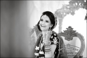 world best Indian wedding photographers candid photo of happy indian bride on her wedding day