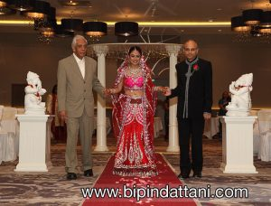 Rupa's entrance in red wedding outfit at her London Hilton Wembley wedding