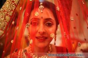 indian bride photo shoot posing with lehenga