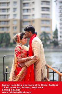 happy couple portrait shoot near river Thames in London by indian wedding photographer Bipin Dattani